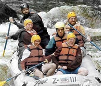 Residents at New England Village whitewater rafting